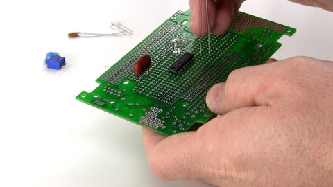 Assemble circuit with through hole components; time-lapse Footage
