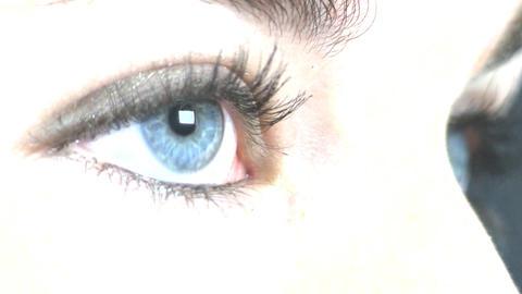 Teenage girl blue eye macro; 2 Footage