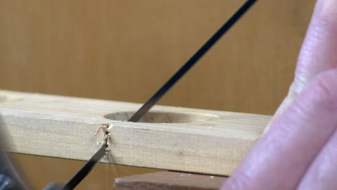 Cutting with a coping saw Footage