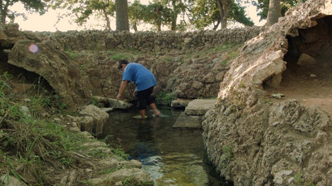 Boy Steps into Spring Water