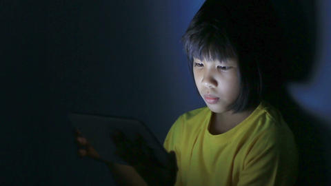 HD footage, close up girl playing tablet pc at night Footage