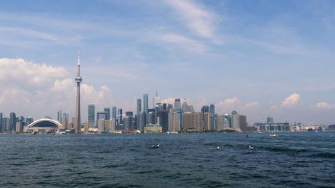 Airplane Flying In Front Of Toronto Skyline stock footage