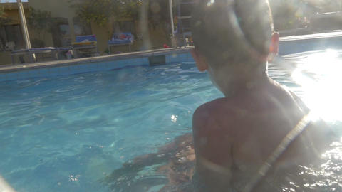 They enjoying swimming and diving in the pool Footage