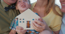 Real estate concept with happy family and small wooden house Footage