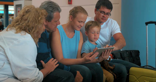 Family with tablet pc computer in the airport Footage