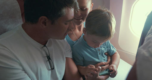 Boy Playing Games in Smartphone, Parents by Him Footage