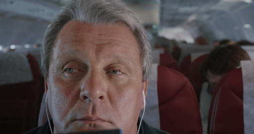 Man In Plane Falling Asleep stock footage