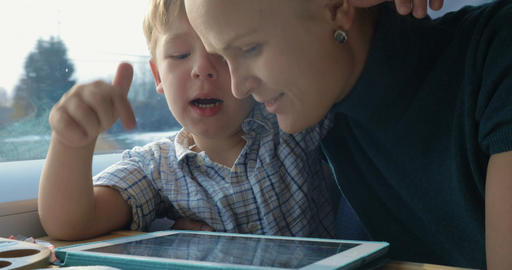 Boy and His Mother Watching Cartooins in Tablet Footage