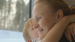 Little child embracing mother in train Footage