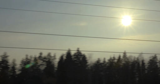 Evening scene of passing landscape with sun and trees Footage