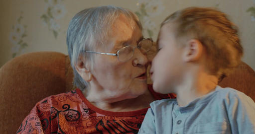 Grandson kisses his grandmother Live Action