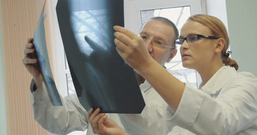 Doctors analyzing the results of x-ray examination Footage