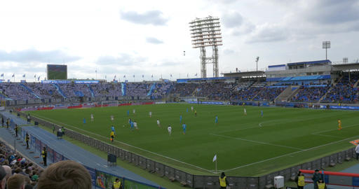 Football Match Before Crowded Stands At The Stadium stock footage