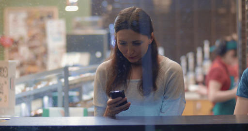 Young Woman Writing Messages in Smartphone Footage