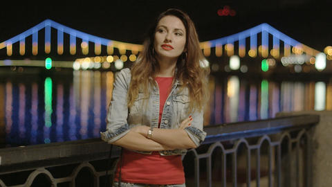Lonely Woman Waiting for Someone at Night on the Bridge with Reflections in the Footage