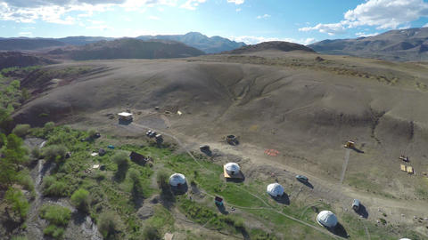 flight over nomadic yurt camp in Altay mountains Footage