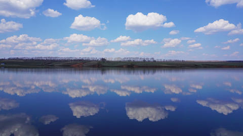 Clouds are reflected in lake - timelapse Footage
