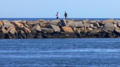 Boys On Breakwater stock footage