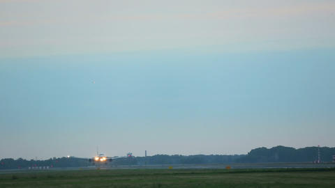 Airplane Landing In The Early Morning stock footage
