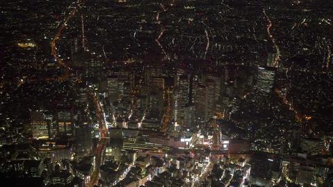 Shinjuku buildings light up aerial tokyo,Japan Live Action