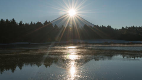 Double Sunrise behind dark Mt'fuji silhouette time lapse Footage