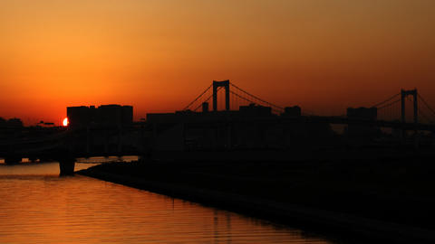 Beautiful sunset behind Rainbow bridge Tokyo,Japan Footage