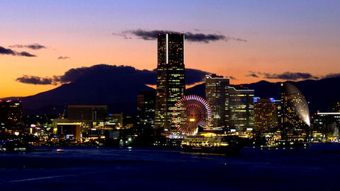 close up Timelapse view of yokohama at twilight with minatomirai and Mt Fuji on  Footage