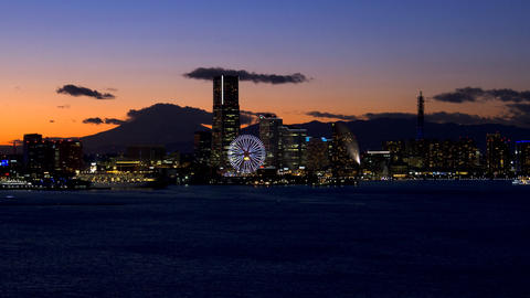 Timelapse view of yokohama at twilight with minatomirai and Mt Fuji on the backg Footage