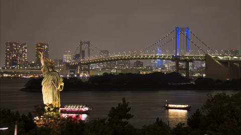Replica of the statue of liberty and the rainbow bridge. Odaiba, Tokyo, Japan Footage