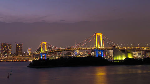Night View Of The Rainbow Bridge and Tokyo Tower Tokyo, Japan Footage