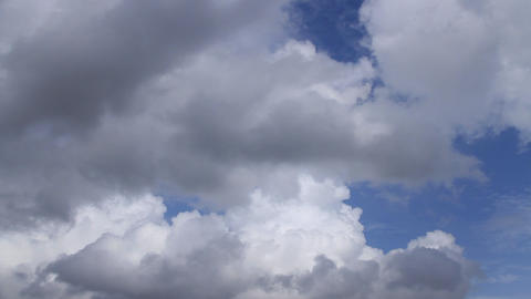 White clouds running over blue sky Live Action
