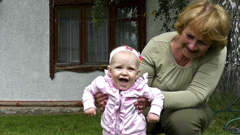 Grandmother Plays With Granddaughter stock footage