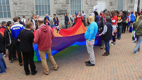 People Holding A Huge Rainbow Flag/banner 2 stock footage