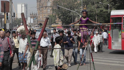 Indian tightrope walker in the city Footage