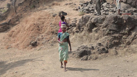 Indian Farmers Carry The Stones On Their Heads.