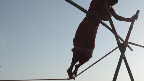 Indian Tightrope Walker On The Beach stock footage