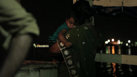 Mariner manages noisy engine on Indian boat in the night Live Action
