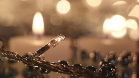 candles and christmas lights close-up rack focus Footage