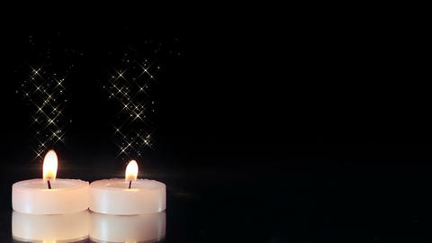 two candles burning seamless loop Footage