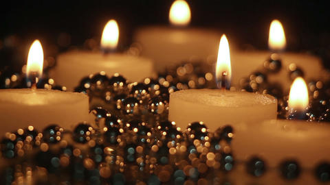 burning candles and beads in night seamless loop Footage