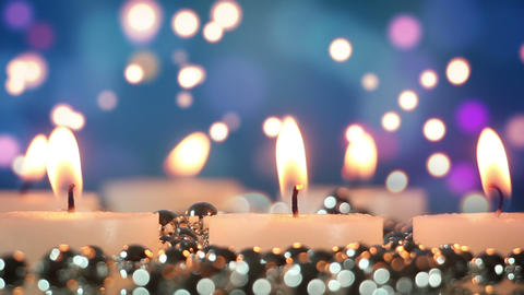 burning candles and bokeh lights loopable Footage