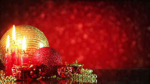 christmas decorations and snowfall on red background loop Stock Video Footage