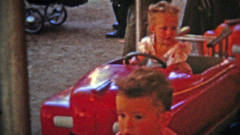 1951: Kiddieland Amusement Park girl enjoying the latest rides Footage