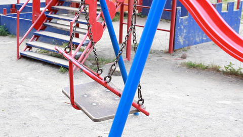 Empty swings swaying at playground Footage