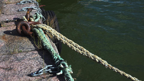 The iron ring on the dock. Ropes. 4K Footage