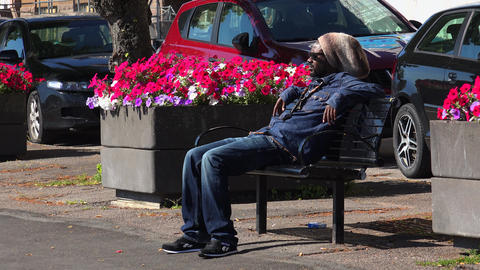 African American in the park on a bench resting. 4K Footage