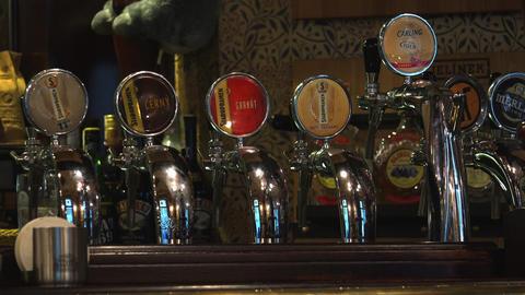 Cranes for bottling beer in a bar. 4K Footage