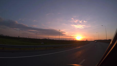 Evening sunset, highway, traveling by car. 4K Footage