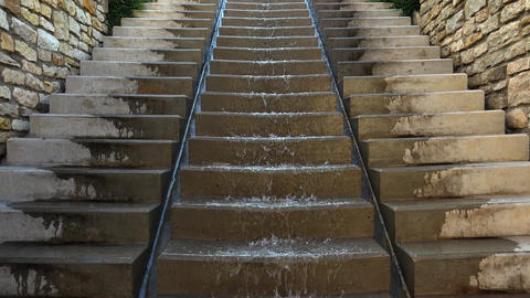 The water runs down the stairs. Fountain. 4K Footage