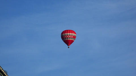 Red hot air balloon in the blue sky. 4K Footage